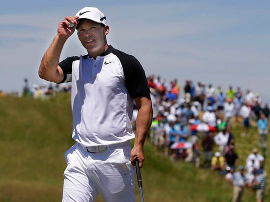 Paul Casey greets the crowd after he finishes on No. 9 during the second round of the U.S. Open at Erin Hills on Friday.