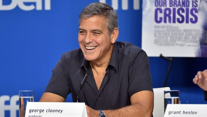 """George Clooney speaks onstage during the """"Our Brand Is Crisis"""" press conference at the 2015 Toronto International Film Festival at TIFF Bell Lightbox on Sept. 12, 2015 in Toronto."""
