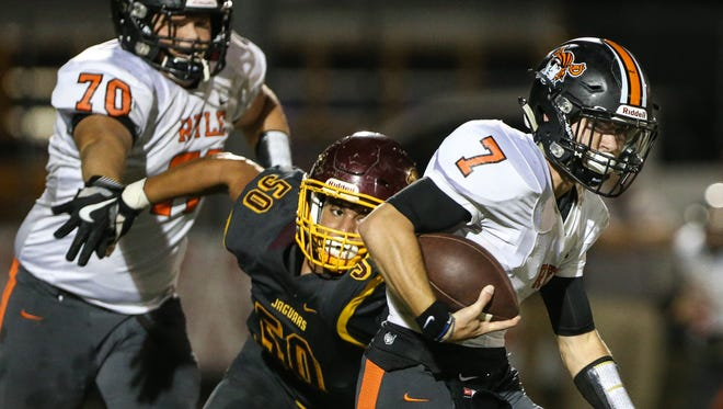 Cooper's Michael Attabary tries desperately to get a hand on Ryle quarterback Easton Pilyer during their game at Cooper, Friday, October 6, 2017.
