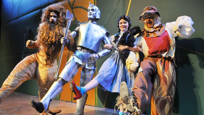 """Richard Klenotich II of West Melbourne as the Lion, Daniel Grest of Palm Bay as the Tin Man, Kirstin Williams of Melbourne as Dorothy Gale and Dillon Gilles of Port St. John as the Scarecrow star in """"The Wizard of Oz"""" at the Henegar Center."""