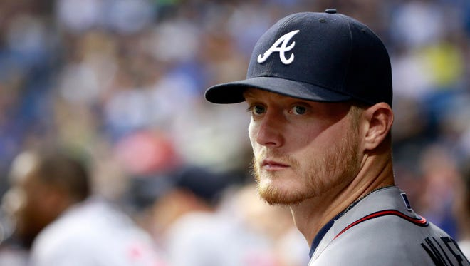 Atlanta Braves pitcher Shelby Miller (17) looks on in the dugout against the Tampa Bay Rays at Tropicana Field.