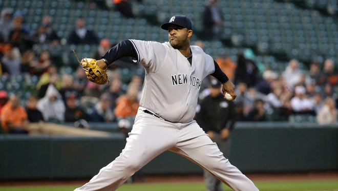 New York Yankees starting pitcher CC Sabathia throws to the Baltimore Orioles in the first inning of a baseball game in Baltimore, Wednesday, May 4, 2016.