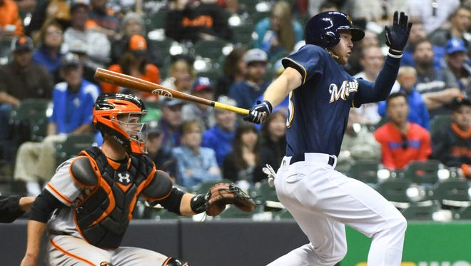 The Brewers' Brett Phillips hits a single in the eighth inning for his first major-league hit.