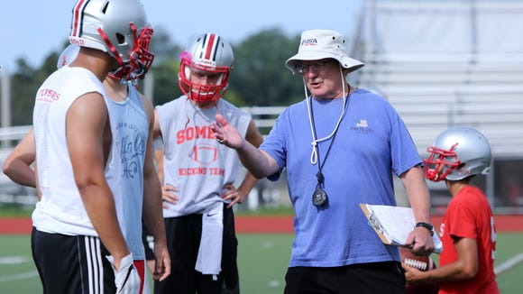 Coach Tony DeMatteo runs drills on the first day of