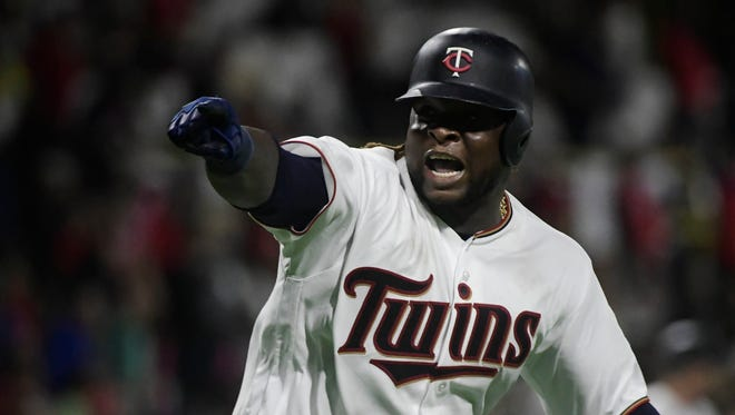 Minnesota Twins' Miguel Sano celebrates after hitting a home run against the Cleveland Indians.