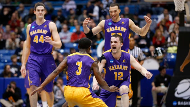 Albany guard Peter Hooley and guard DJ Evans celebrate after the Great Danes defeated Mount St. Mary's.