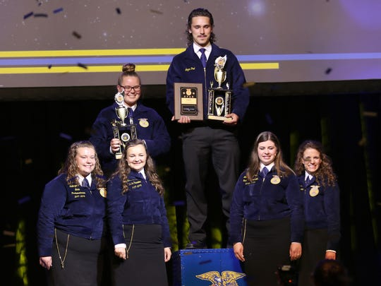 Logan Paul, of Randolph Cambria-Friesland FFA, is named the Wisconsin Star in Agribusiness during the Wisconsin State FFA Convention on June 13 in Madison. Runner-up Anne Runde (left) is also pictured.