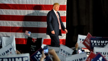 Donald Trump walks to the podium at the start of a campaign rally in Colorado Springs, Colo., on Oct. 18, 2016.