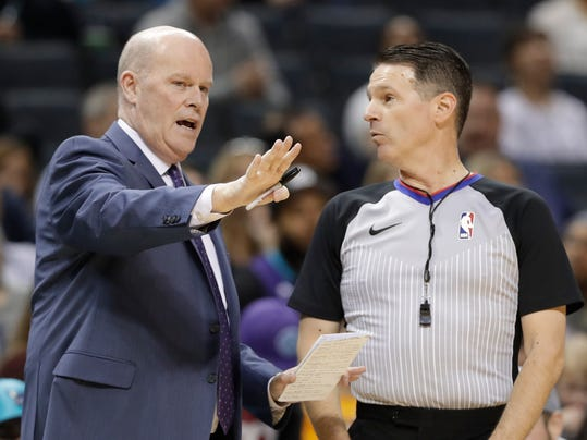 Charlotte Hornets head coach Steve Clifford, left, argues a call with referee Pat Fraher, right, during the first half of an NBA basketball game against the Indiana Pacers in Charlotte, N.C., Sunday, April 8, 2018. (AP Photo/Chuck Burton)