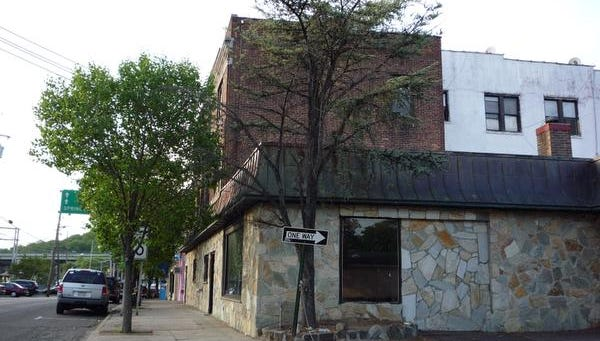 This building at 122 Orange Ave. would be torn down once Orange Avenue Associates LLC moves forward with its luxury rental apartment development.