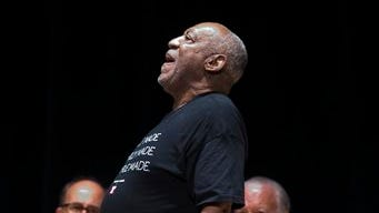 Entertainer and former classmate Bill Cosby speaks during a public memorial service for Philadelphia Inquirer co-owner Lewis Katz Wednesday,, at Temple University in Philadelphia. Katz and six others died when his private jet crashed during takeoff on Saturday, May 31, 2014, in Massachusetts. He was 72.