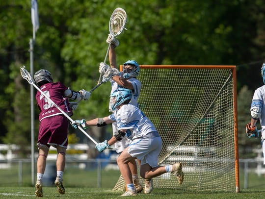 CBA goalie Christopher Downey makes a save stopping