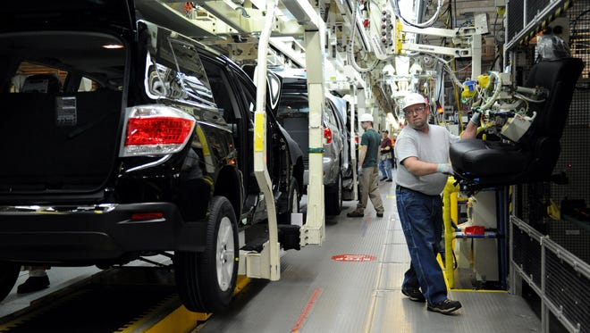 File photo of a worker on the line at the Toyota plant in Princeton, Ind. Several parts suppliers settled with the Justice Department on charges they conspired to fix prices on , on Wednesday, Feb. 8, 2012. Toyota says it will expand its factory in Princeton, Indiana, and add 400 jobs so it can build more Highlander SUVs. (AP Photo/The Evansville Courier & Press, Erin McCracken)