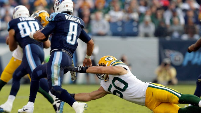 Tennessee Titans quarterback Marcus Mariota (8) eludes Green Bay Packers inside linebacker Blake Martinez (50) during the Green Bay Packers 47-25 loss to the Tennessee Titans during the NFL football game at Nissan Stadium in Nashville, Tennessee,Sunday, November 13, 2016.