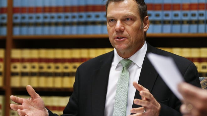 A federal judge approved a deal Wednesday where the state would pay legal fees stemming from a lawsuit against a voting law backed by former Secretary of State Kris Kobach.