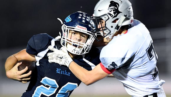 Enka's Jackson Smith is caught by Robbinsville's Seth