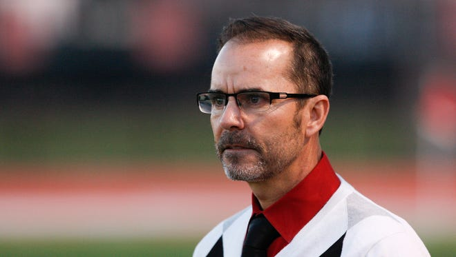 U of L head coach Ken Lolla watched his team play Louisville FC during their soccer match at U of L.March 11, 2015