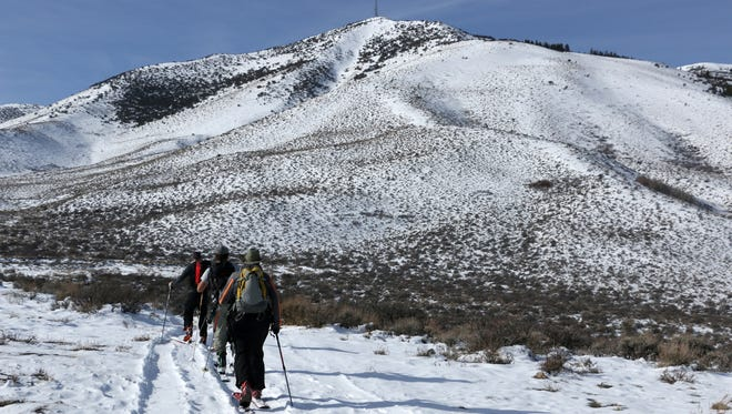 Skiers begin their skin trail up Peavine Peak north of Reno on Feb. 6, 2016.