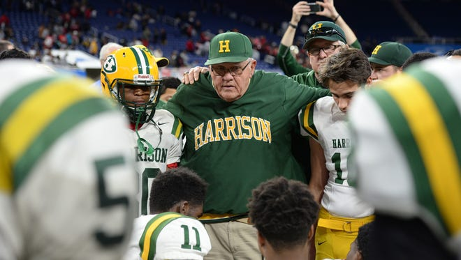 Farmington Harrison coach John Herrington addresses his team after the Division 3 state final game.