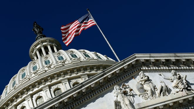 An American flag waves outside the United States Capitol building.