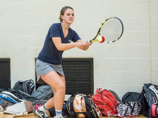 Sarah Ogle practices inside the gym at Delta High School