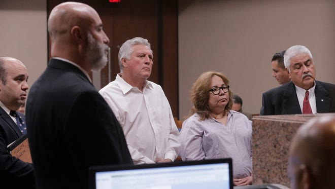 Antonio Huerta and Sandra Rodriguez Huerta stand before 205th District Court Judge Francisco X. Dominguez (not shown) along with their attorney, Francisco F. Macias, right, during their October arraignment. District Attorney's Office trial team chief for the rape and child abuse unit Beto Acosta, left, along with the court bailiff, second from left, listen as Dominguez reads the charges against the Huertas.