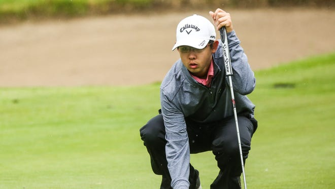 Section 1's Nathan Han reviews the 6th green during Round 1 of the NYSPHSAA at Robert Trent Jones Golf Course in Ithaca, NY.