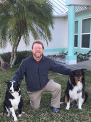 Paul Chinaris of Port St. John poses with his dogs