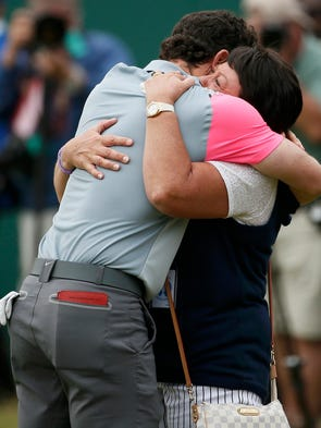 Rory McIlroy of Northern Ireland celebrates with his mother Rosie on the 18th green after winning the British Open Championship at the Royal Liverpool Golf Club.