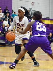 LSUA's Pearl Paulo (23, left) looks to get past Wiley College's Ty Colquitt (23, right) Saturday.-Melinda Martinez/The Town Talk