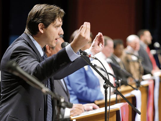 MARK LAMBIE—EL PASO TIMES  Josh Dagda, candidate for City Council District 8, criticized incumbent Cortney Niland as he answers a question about cost overrun on the Chihuahuas ballpark.