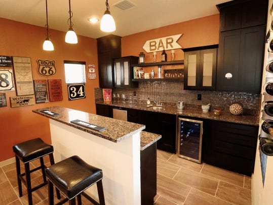 Metro Homes' Brooklyn floor plan has a wet bar next to the open kitchen. The 1,753 square-foot, three-bedroom home sells for 182,450.