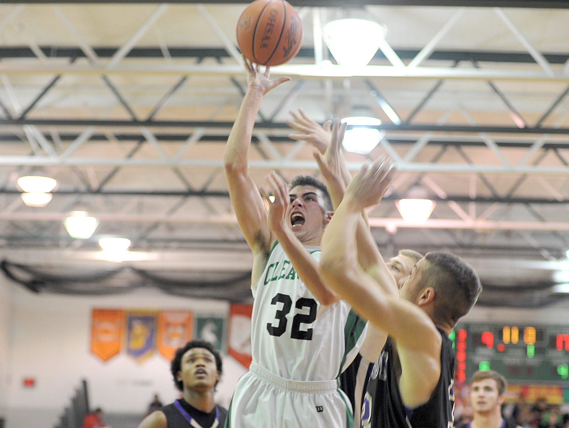 Clear Fork's Christian Beer soars to the basket Friday night as the the Colts hosted Lexington High School.