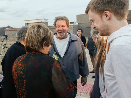 Brad Jennings laughs with his family after he was released