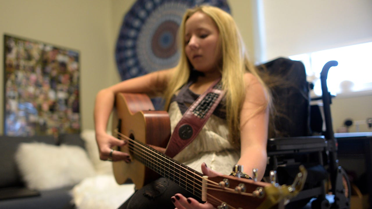 Music helped Ali McManus endure 10 surgeries, a body cast and physical pain from bone and spine disorders