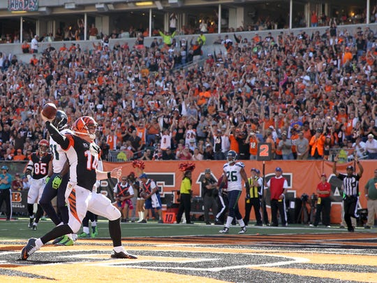 Bengals quarterback Andy Dalton spikes the ball after scoring in the fourth quarter during Sunday's win over the Seahawks.