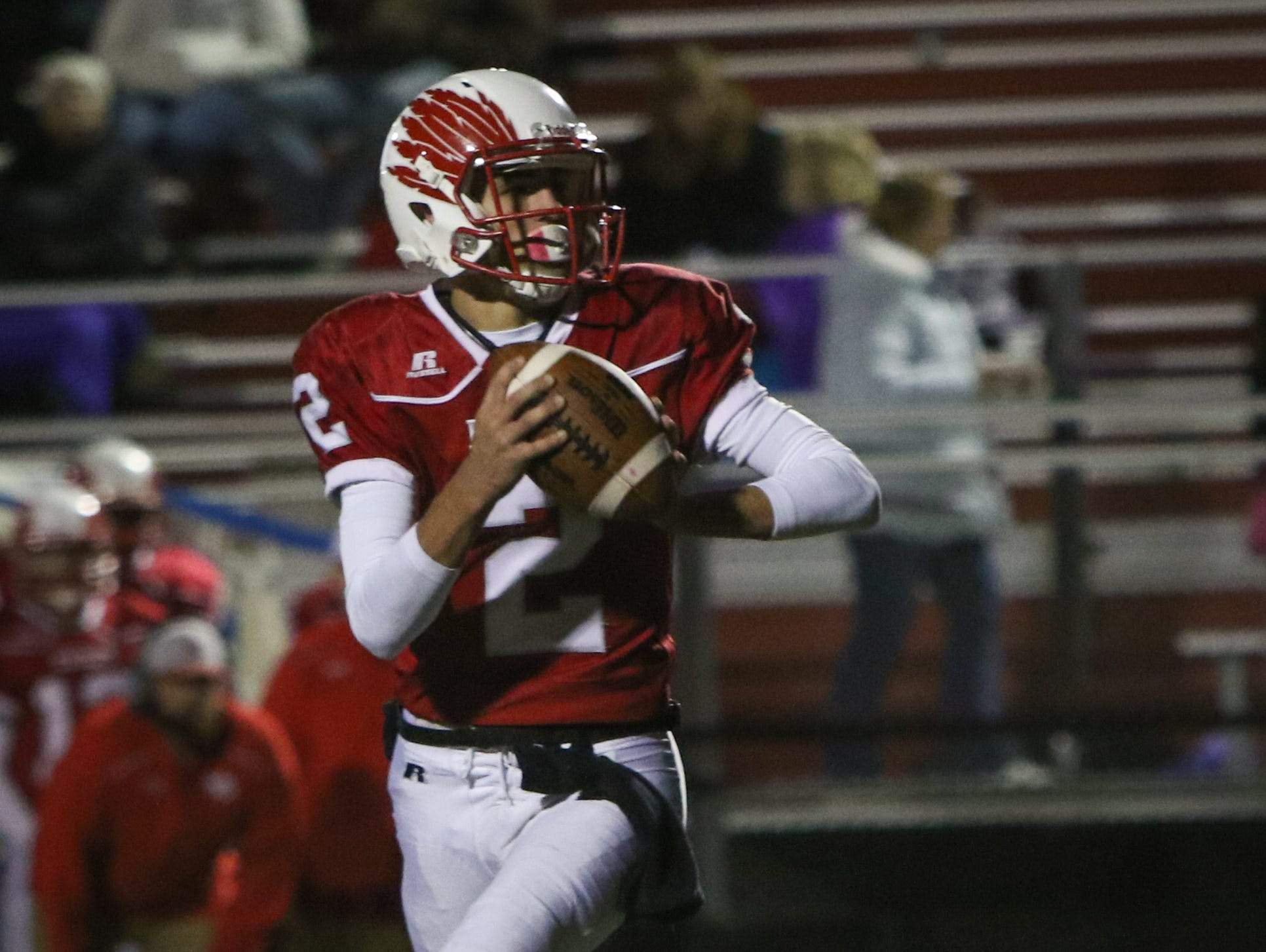 Smyrna quarterback Nolan Henderson rolls out for a pass in the third quarter. Smyrna defeats previously undefeated Sussex Tech 42-0 at Smyrna Saturday.
