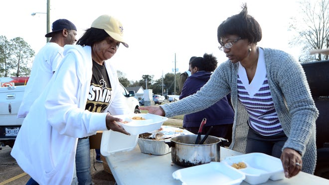 Hattiesburg volunteers Brenda Dillion and Vanessa Molden put together boxes of food to give out to tornado victims, law enforcement and others in need of food on Sunday.