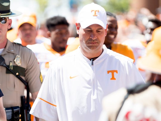 Tennessee Head Coach Jeremy Pruitt walks in the Vol Walk during the Tennessee Volunteers Orange & White spring game at Neyland Stadium in Knoxville, Tennessee on Saturday, April 21, 2018.