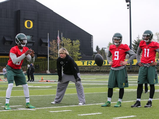 David Yost, center, works with QBs during opening day
