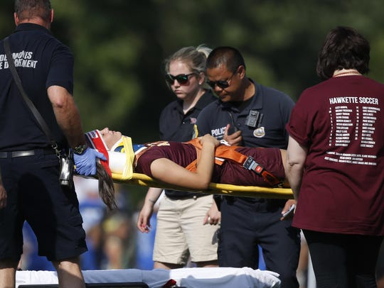Ankeny sophomore Chloee Kooker gets taken off the field