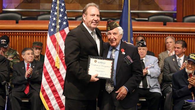 Sen. Joseph Robach, left, poses with new State Senate Veterans Hall of Famer Anthony Ferrarese of Greece.
