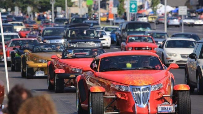 Cars drive along Woodward Avenue during the 2013 Woodward Dream Cruise.