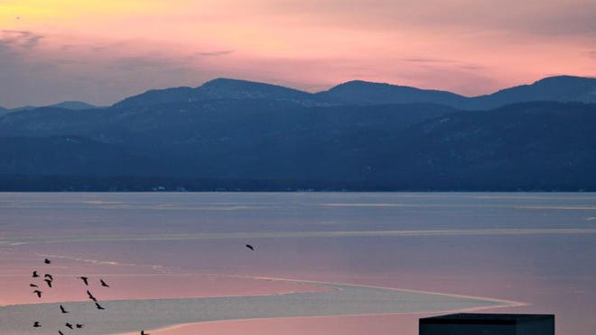 Lake Champlain is largely frozen over, according to the National Weather Service office in South Burlington. The last time the lake had this level of ice cover was 2007. This sunset view from last week shows only a narrow channel open in the ice west of Burlington, and it has since iced over.
