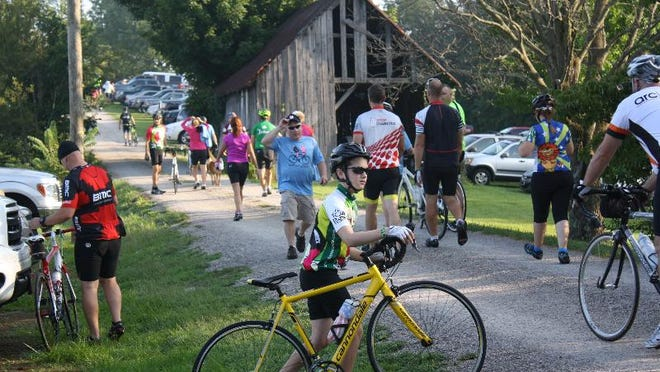 Joshua Sims, 11, heads to the starting point for the annual Le Tour de Pork bike ride at Turtle Run Winery in Harrison County on Saturday.  August 8, 2015