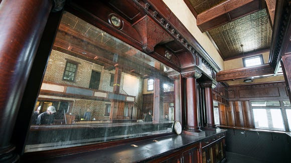 A 19th century bar that came from Pittsburgh was blended into the new wood surrounding it. Paul Kuehnel - Daily Record/Sunday News