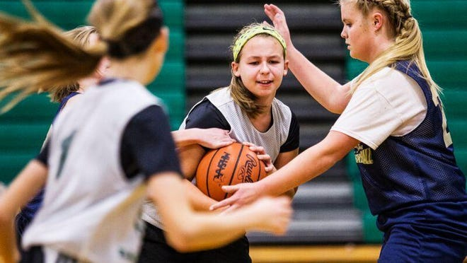 Kayla Grennes fights to hold on to the ball for her team in the Be Smart Be Fast Pennfield Girls Basketball League.