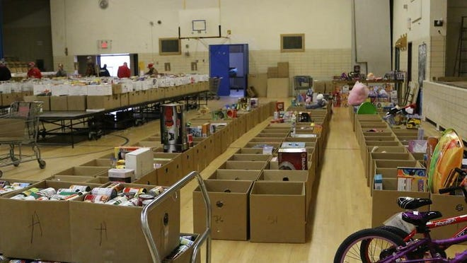 Last year, the Farmington Area Goodfellows packed more than 30,000 cans and boxes of food.