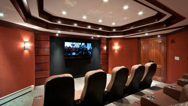 A movie theater designed by DH Audio and Home Theater.