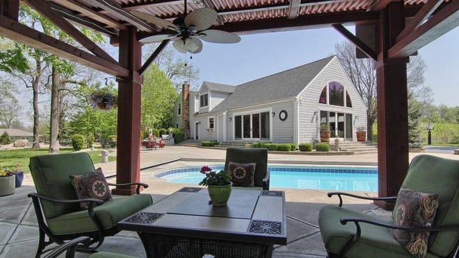 The pergola out back provides a view of the pool and a shady place to relax.